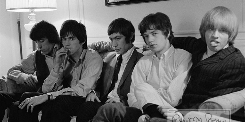 Mike Jagger, Keith Richards, Brian Jones of The Rolling Stones wait for a press party at a hotel in New York in 1965. Photo by Bob Bonis