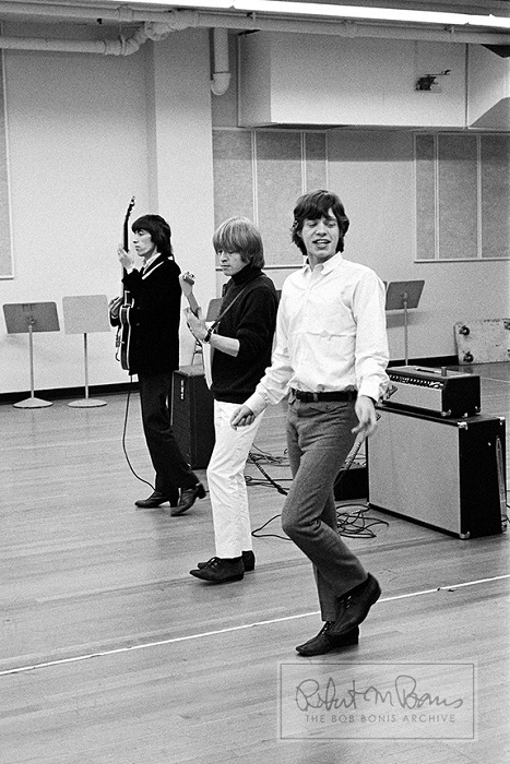 Bill Wyman with Biran Jones and Mick Jagger rehearsing in studio for a Rolling Stones appearance on TV show Shindig. Image by Bob Bonis