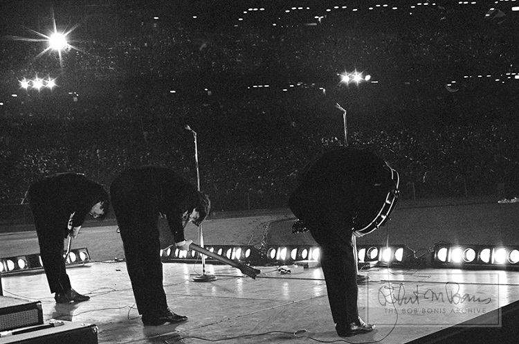 The Beatles take a bow on stage at the Metropolitan Stadium in Bloomington, Minnesota, August 21, 1965.