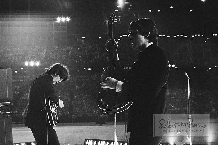 Paul McCartney and George Harrison perform at the Metropolitan Stadium in Blooming, Minnesota, August 21, 1965.