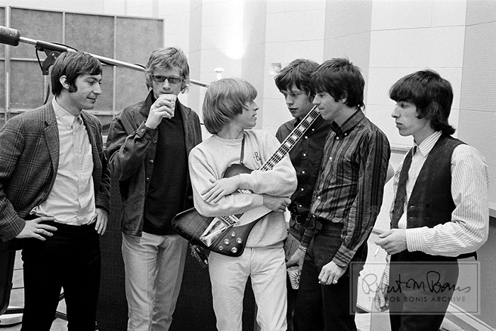 After a recording session at RCA Studios in Hollywood, California, May 12-13, 1965, Bob Bonis captures this striking portrait of the Rolling Stones and their producer, Andrew Loog Oldham.
